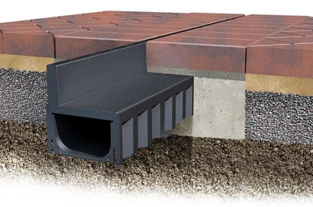 Hidden drainage channel for block paving
