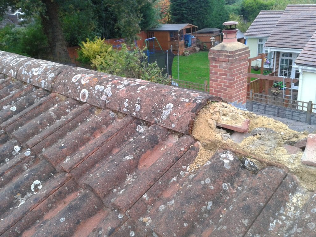 Old dusty and flaky cement to ridge tiles