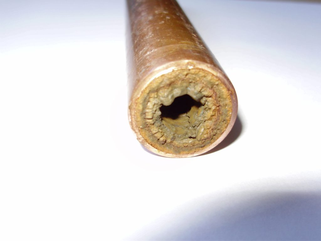 Limescale and sludge in pipe